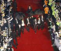 Excited fans are held back by police as stars stroll down the red carpet at the Pusan International Film Festival in South Korea. | PHOTO COURTESY OF PUSAN INTERNATIONAL FILM FESTIVAL