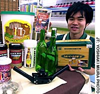 A shop assistant shows off some of the wide selection of homebrewing supplies available at the Tokyu Hands store in Shibuya, Tokyo.
