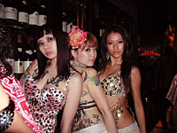 The Cabunny dancers (above) pose at an event called Rouge, held every third Saturday; right: party people raise a toast