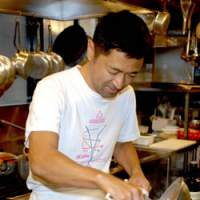 Chef Tsutomu Ishikawa, left, prepares a pasta dish, gomiti rigati alla Norma, seen far left, at his restaurant Don Ciccio. | YOSHIAKI MIURA PHOTOS