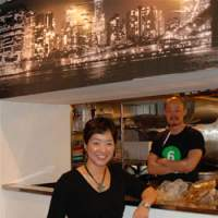 Owner Suji Park stands proud at her restaurant Suji's, as manager Kyu Chah looks on from the kitchen; the spicy Mexican scrambled eggs with chorizo and salsa (below) are a popular staple with the all-day brunch crowd. | ROBBIE SWINNERTON PHOTOS