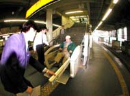 Staff at JR Tamachi Station crank up the special escalator.