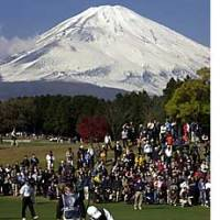 With Mount Fuji as a magnificent backdrop, David Duval of the United States exits a 2nd-hole bunker during the World Golf Championship-EMS World Cup played at the Taiheiyo Club in Gotemba, west of Tokyo, in November 2001.