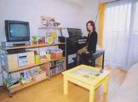 Mikiko Arima at home in her tidy room, with her favorite things neatly on display.