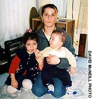 Meryem Kosan and her children Merve and Mehmet.