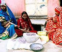 Women in the Suraj Pole slum smash gemstones for use in handicrafts.