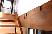 A beam in the Takano house bears the routed marks of joints from some previous use of the ancient timber.