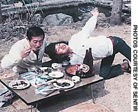 Teenage Shinya Tasaki strikes a dramatic pose with his father on a family picnic in Okutama, western Tokyo in 1976.