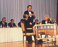 Shinya Tasaki on test before the judges  (above) at the 8th World Best Sommelier Competition in Tokyo in 1995, and standing with his winner's medal between the two runners-up.