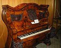 The Napoleon Hat Shape Piano was made in England in 1853 as a wedding gift for Napoleon III from Queen Victoria.