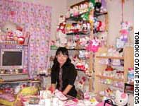 Asako Kanda with some of her Kitty appliances and furnishings and some of 100-odd Hello Kitty soft toys she calls her 'kids'