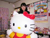 Hello Kitty superfan Asako Kanda -- who says that she feels antsy if she's not surrounded by Hello Kitty gear -- poses proudly with her huge inflatable Hello Kitty balloon at her and her husband's Kittified apartment in Tokyo's Shibuya Ward.