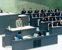 Joji Yamamoto (standing) addresses the Tokyo Metropolitan Assembly after being elected to the capital's governing body in 1989 following four years he spent working as a secretary to Naoto Kan, a leading Diet member of the Democratic Party of Japan.