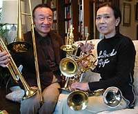 Yoshio and Keiko Toyama with instruments donated to their Wonderful World of Jazz foundation