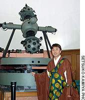 Buddhist priest Ryo Kasuga beside his planetarium project