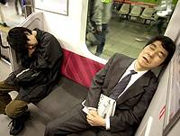 Two comotose commuters on a Tokyo train
