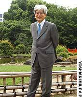 Takeshi Yoro before his JT interview. 'I don't usually dress like this,' he explained, 'but my wife chose this outfit as I had to make a speech to a group of bankers today.'