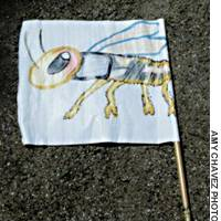 A termite banner carried by marchers in the Mushi Okuri ceremony.