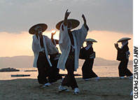 Islanders perform the Shiraishi Dance on the beach during Bon.