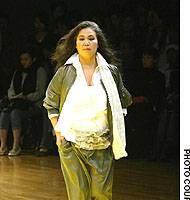 One of Limi Yamamoto's models who ever so slightly startled the assembled fashionistas as she took to the runway to showcase an ensemble aimed at young, young ladies.