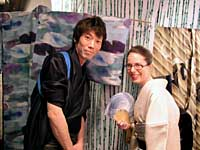 Maia Maniglier poses with kimono stylist Kanji Nakashima at their first exhibition in Tokyo in May 2003. Behind them are yukata designs by Hiroshi Goto and Tatsuya Oka. | PHOTOS COURTESY OF MAIA MANIGLIER