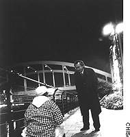 Osamu Mizutani engages a youth in the small hours by the Yokohama waterfront during one of his lone ``night guard-teacher'' patrols, when he aims to help young people whose lives may be taking a wrong or dangerous turn.
