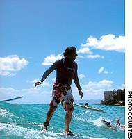 Gene Krell longboards off Waikiki, Honolulu