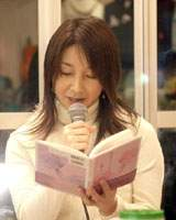 Chisato Daigo reads a poem about her children at an Open Mic Up! event in Tokyo.