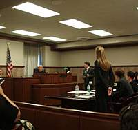 In the role of prosecution attorney, a student taking part in the National High School Mock Trial Championship in Oklahoma City raises an objection during a supposed second-degree murder case.