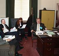 After a mock trial, legal professionals who are the judges in the Oklahoma championship discuss how to score the participating teams of students.