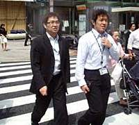 Workers in sunny central Tokyo last week combine a casual air and Cool Biz sense as they shed neckties and more