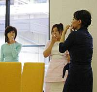 Training clinic staff in breathing, smiling and voice intonation are all part of Omori's business strategy.