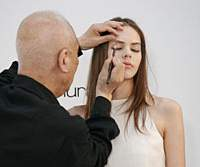 Shu Uemura shows off his world-renowned brushwork skills on a model at a recent on-stage demonstration in Tokyo. Asked whether he still practices his makeup techniques, Uemura says, 'when you've mastered [technique] it's about feelings, about your heart.'