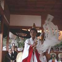 A young virgin dances for the Shinto gods at Shiraishi Island's fall festival. | AMY CHAVEZ PHOTO