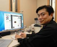 Joi Ito at his office in central Tokyo. A master of multitasking, he gets his work done mostly through the use of instant messenger services and Internet phone calls. | YOSHIAKI MIURA PHOTO