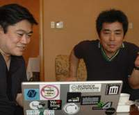 Joi Ito (left) with his friend the renowned writer Ryu Murakami. In May 2006, they published 'Ko wo Mitsumeru Daiarogu (A Dialogue Pondering on Individuality),' a book based on their conversations on topics including individuality, nationhood and self-expression. | PHOTO COURTESY OF DIGITAL GARAGE