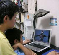 A father and son watch an 'Ultraman' DVD together on dad's laptop, a typical sight this year in many family households. | JAPAN TIMES IMAGE PHOTO