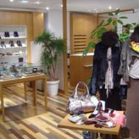 The rt store in central Tokyo's upscale Ginza district (above) may replicate high-end outlets, but all its goods are pre-owned. A mannequin in the store (left) is kitted out in a Giorgio Armani beret priced at 5,145 yen (30,000 yen new), a Marni jacket priced at 62,790 yen (180,000 yen new) and a Gucci skirt going for 20,790 yen (80,000 yen new). | MARTIN WEBB PHOTOS
