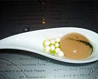 Jeff Ramsey (top) makes carrot caviar in the Molecular Tapas Bar, which uses the same sodium alginate as the miso soup (middle); while a customer (above) squeezes his own soba through a syringe, prior to tucking into the odd-looking apricot-and-coconut dessert (below) — then perhaps heading off to the picturesque mensroom (bottom).   YUMI WIJERS-HASEGAWA PHOTOS; PHOTO COURTESY OF MADARIN ORIENTAL