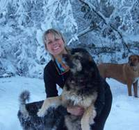 Animal-rights activist Allison Lance and one of her five dogs romp after a snowstorm in washington last year.