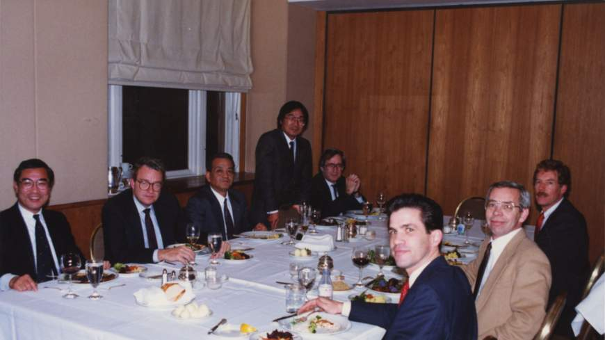 Work and play: Hidetoshi Masunaga (standing) at a meal to celebrate a deal he and colleagues struck with U.S. lawyers in Seattle in 1988.
