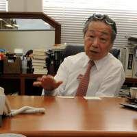 Pressing issue: Hidetoshi Masunaga, an elite lawyer who is spearheading a campaign to rectify 'discrimination based on a voter's address,' displays one of more than 100 full-page opinion adverts his group has run in the vernacular media. | SATOKO KAWASAKI