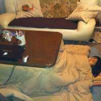Six-year-old Akari Bhandari of Hiroshima shows how she sleeps under the kotatsu — sans futon! courtesy of Ajit Bhandari,