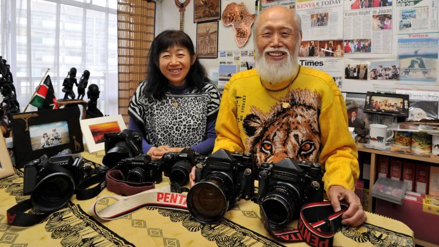 Out of Africa: Michio Hiraiwa and his daughter, Masayo, pose at their African photo and craft gallery in Tokyo's Suginami Ward. The duo have traveled to Kenya together nearly 140 times and taken a total of 3,700 Japanese tourists to the country.