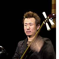 Shinichi Kinoshita  looking stern as he concentrates hard during a rehearsal with his tsugaru shamisen at Ebisu  Garden Hall in Tokyo.