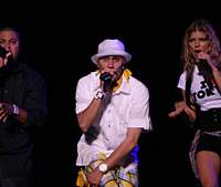 Fergie (above, far right) and her Black Eye Peas cohorts woo the masses at Summer Sonic 07, which took place simultaneously last weekend in Chiba and Osaka; Lovefoxxx (below) of Brazilian electro act Cansei de Ser Sexy grabbed the limelight clad in a striking, striped leotard. | &#169; SUMMER SONIC 07