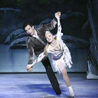 Prince Siegfried (Vadim Yarkov) with his muse Odette (Olga Sharutenko), in 'Swan Lake On Ice.'