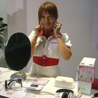 A Konami employee demonstrates the 'Dream Skincare' title for Nintendo DS portable conole.
