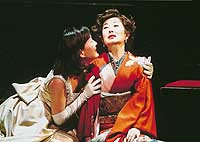 Mitsuko Mori (above, right) in the play's central role is consoled by her daughter, and waited on by her butler, along with her older brother (below).