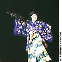 Ichikawa Ennosuke, as Nitta Kiryumaru in disguise, makes a flying exit to his mountaintop hideout in 'Yotsuya Kaidan -- Chushingura.' In the play's final act (below) Sato Yomoshichi  (Ichikawa Ukon) and Ono Sadakuru (Ichikawa Shun'en) subdue Kiryumaru at the great waterfall in the Myojin Mountains.